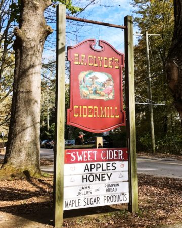 Clyde's Cider Mill, Mystic, CT - Visit BF Clyde's Cider Mill in Old Mystic, CT for the best apple cider and cider donuts anywhere! This 137-year-old steam powered cider mill (the oldest in the US) is a must if you're in Southestern CT in the fall. #clydescidermill #newengland #connecticut #mysticct #newenglandtravel #connecticuttravel #thingstodoinct #fallinct #fallinnewengland